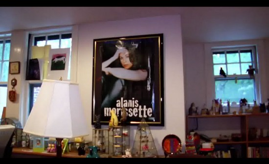 A scene from Transcendent Man displaying Kurzweils chotchkies and Alanis Morissette poster