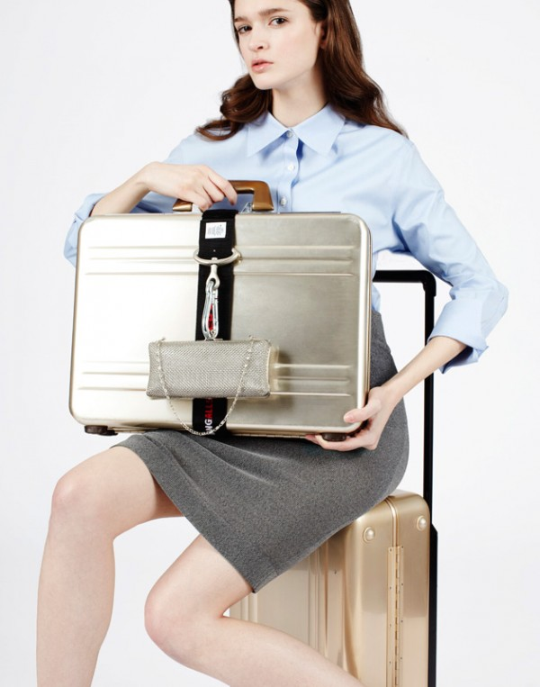 Skirt by Adidas SLVR, suitcase and briefcase by Halliburton, clutch by Jessica McClintock.