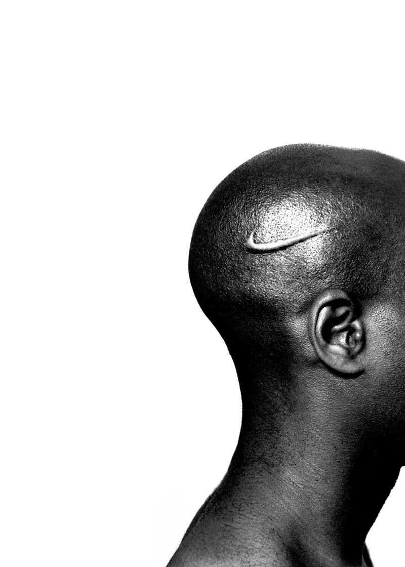 Hank Willis Thomas, Branded Head, series: Branded, Lambda photograph, 40 x 30 inches, 2003.
