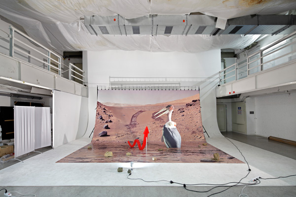 Pattern of Activation (on Mars), 2014 installation: photo backdrop, stones, Accelerated Growth Potential, 2013, polyurethane rubber, aluminum stand, Approximation Mars II, 2014, digital print on aluminum, cutout display