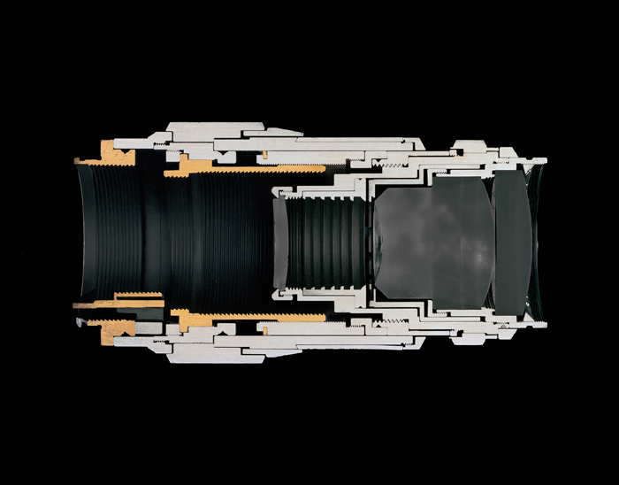Christopher Williams Cutaway model Leica Leitz Wetzlar Tele-Elmar 135/4.0 Focal length: 135 mm Aperture range: 4 – 22 Number of elements/groups: 4/4 Focusing range: 1.5 m – infinity Angle of range: 18 degrees Filter thread: 39 mm Weight: 405 g Dimensions: 53.4 × 122.69 mm Manufacturer part number: 11850 Lens design by Dr. Walter Mandler Manufactured by Ernst Leitz GmbH, Wetzlar, Germany Studio Rhein Verlag, Düsseldorf March 14, 2013, 2014 Selenium toned gelatin silver print 14 1/2 x 18 1/2 inches (36.8 x 47 cm). Courtesy David Zwirner, New York/London and Galerie Gisela Capitain, Cologne.