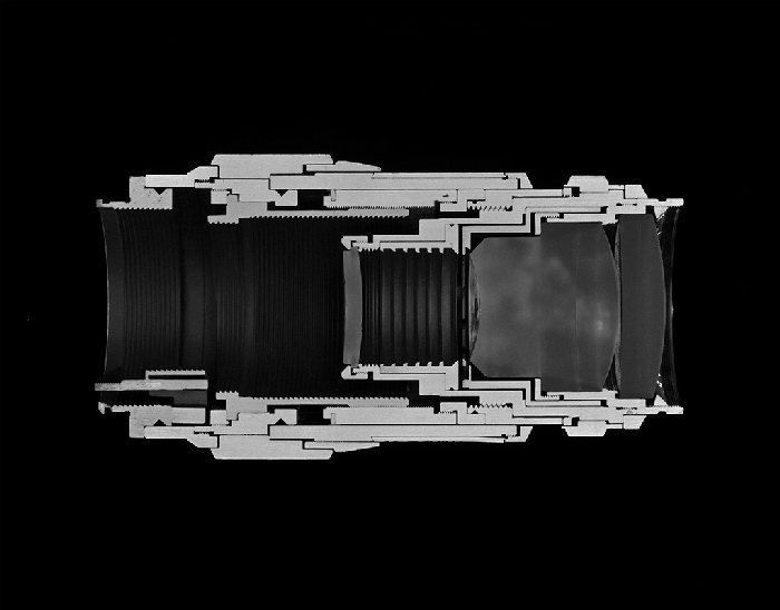 Christopher Williams Cutaway model Leica Leitz Wetzlar Tele-Elmar 135/4.0 Focal length: 135 mm Aperture range: 4 – 22 Number of elements/groups: 4/4 Focusing range: 1.5 m – infinity Angle of range: 18 degrees Filter thread: 39 mm Weight: 405 g Dimensions: 53.4 × 122.69 mm Manufacturer part number: 11850 Lens design by Dr. Walter Mandler Manufactured by Ernst Leitz GmbH, Wetzlar, Germany Studio Rhein Verlag, Düsseldorf March 14, 2013, 2014 Selenium toned gelatin silver print 14 1/2 x 18 1/2 inches (36.8 x 47 cm) Courtesy David Zwirner, New York/London and Galerie Gisela Capitain, Cologne.