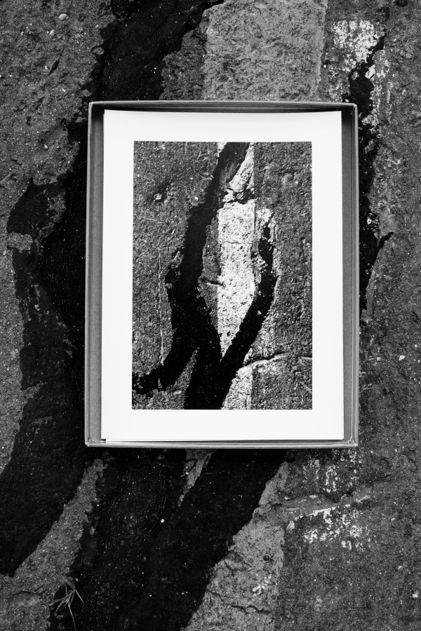Sara VanDerBeek (b. 1976, United States) Past Present Highlighting the graphic gestures found written in the tar lines crisscrossing the pier, Sara VanDerBeek, upon her first visit to the pier, photographed a series of small, graphic moments inscribed on the pier's surface. She subsequently instructed the photographer to rediscover and rephotograph those same signs – a memory action activated by the premise of the entire Pier 54 project.