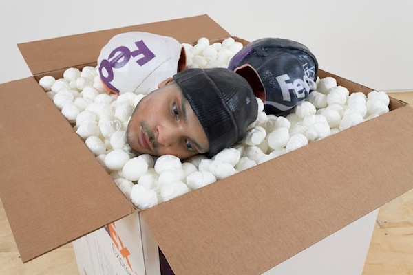 Josh Kline: Packing for Peanuts (Fedex Workers Head with Knit Cap), 2014