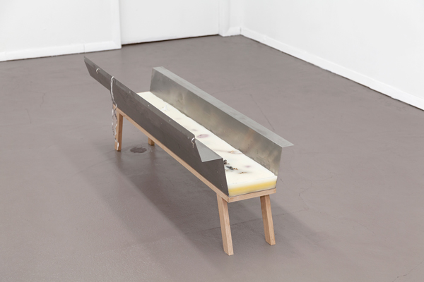 Miami-Dutch, Trough, 2015, Stainless steel, beeswax, paraffn wax, oak, fowers, fsh bone, paper, earrings, shoelace, 18.75 x 48 x 15 inches (47.63 x 121.92 x 38.10 cm), Unique